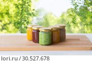 Купить «vegetable or fruit puree or baby food in jars», фото № 30527678, снято 21 февраля 2017 г. (c) Syda Productions / Фотобанк Лори