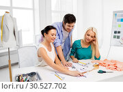 Купить «team of fashion designers working at office», фото № 30527702, снято 17 мая 2014 г. (c) Syda Productions / Фотобанк Лори