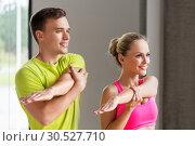 Купить «smiling man and woman exercising in gym», фото № 30527710, снято 29 июня 2014 г. (c) Syda Productions / Фотобанк Лори