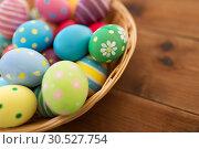 Купить «close up of colored easter eggs in basket», фото № 30527754, снято 15 марта 2018 г. (c) Syda Productions / Фотобанк Лори