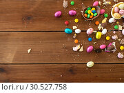 Купить «chocolate eggs and candy drops on wooden table», фото № 30527758, снято 15 марта 2018 г. (c) Syda Productions / Фотобанк Лори