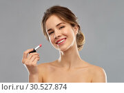 Купить «woman with pink lipstick applying make up», фото № 30527874, снято 20 января 2019 г. (c) Syda Productions / Фотобанк Лори