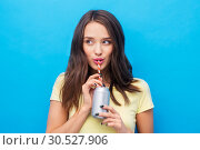 Купить «young woman or teenage girl drinking soda from can», фото № 30527906, снято 29 января 2019 г. (c) Syda Productions / Фотобанк Лори