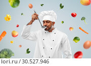 happy male indian chef tasting food from ladle. Стоковое фото, фотограф Syda Productions / Фотобанк Лори
