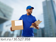 Купить «indian delivery man with parcel box and clipboard», фото № 30527958, снято 12 января 2019 г. (c) Syda Productions / Фотобанк Лори