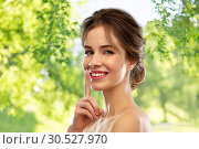 Купить «beautiful smiling woman making hush gesture», фото № 30527970, снято 20 января 2019 г. (c) Syda Productions / Фотобанк Лори