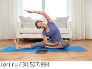Купить «woman with tablet computer doing yoga at home», фото № 30527994, снято 13 ноября 2015 г. (c) Syda Productions / Фотобанк Лори