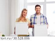 Купить «happy couple with boxes moving to new home», фото № 30528006, снято 25 февраля 2016 г. (c) Syda Productions / Фотобанк Лори