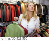 Купить «Woman choosing leather jacket», фото № 30528550, снято 5 сентября 2018 г. (c) Яков Филимонов / Фотобанк Лори