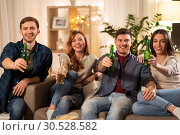 Купить «friends toasting non-alcoholic beer at home», фото № 30528582, снято 22 декабря 2018 г. (c) Syda Productions / Фотобанк Лори