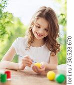 Купить «happy smiling girl coloring easter eggs», фото № 30528670, снято 1 марта 2014 г. (c) Syda Productions / Фотобанк Лори