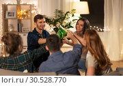 Купить «friends clinking drinks at home in evening», фото № 30528770, снято 22 декабря 2018 г. (c) Syda Productions / Фотобанк Лори