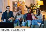 Купить «friends with beer and popcorn watching tv at home», фото № 30528774, снято 22 декабря 2018 г. (c) Syda Productions / Фотобанк Лори