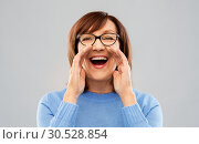 Купить «senior woman in glasses calling over grey», фото № 30528854, снято 8 февраля 2019 г. (c) Syda Productions / Фотобанк Лори