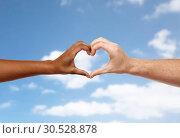 Купить «hands of different skin color making heart shape», фото № 30528878, снято 12 декабря 2013 г. (c) Syda Productions / Фотобанк Лори