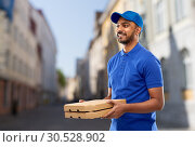 Купить «happy indian delivery man with pizza boxes in city», фото № 30528902, снято 12 января 2019 г. (c) Syda Productions / Фотобанк Лори