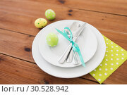 Купить «easter egg in cup holder, plates and cutlery», фото № 30528942, снято 15 марта 2018 г. (c) Syda Productions / Фотобанк Лори
