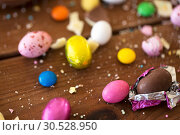 Купить «chocolate eggs and candy drops on wooden table», фото № 30528950, снято 15 марта 2018 г. (c) Syda Productions / Фотобанк Лори