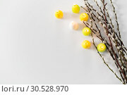 Купить «pussy willow branches and easter egg candles», фото № 30528970, снято 22 марта 2018 г. (c) Syda Productions / Фотобанк Лори