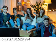 Купить «happy friends watching tv at home in evening», фото № 30528994, снято 22 декабря 2018 г. (c) Syda Productions / Фотобанк Лори