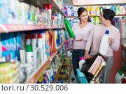 Купить «Women selecting detergents in store», фото № 30529006, снято 18 апреля 2019 г. (c) Яков Филимонов / Фотобанк Лори