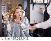 Купить «Young woman is upset by her haircut», фото № 30529042, снято 7 марта 2017 г. (c) Яков Филимонов / Фотобанк Лори