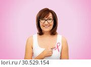 Купить «old woman with pink breast cancer awareness ribbon», фото № 30529154, снято 8 февраля 2019 г. (c) Syda Productions / Фотобанк Лори