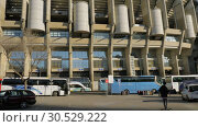 Купить «Outside view of Santiago Bernabeu Stadium with transport parked nearby, Madrid», видеоролик № 30529222, снято 17 января 2018 г. (c) Данил Руденко / Фотобанк Лори