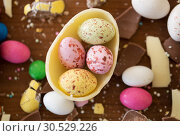 Купить «chocolate egg and candy drops on wooden table», фото № 30529226, снято 15 марта 2018 г. (c) Syda Productions / Фотобанк Лори