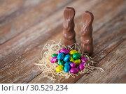 Купить «easter eggs in straw nest and chocolate bunnies», фото № 30529234, снято 22 марта 2018 г. (c) Syda Productions / Фотобанк Лори