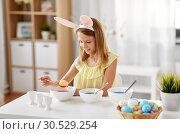 Купить «girl coloring easter eggs by liquid dye at home», фото № 30529254, снято 25 июля 2018 г. (c) Syda Productions / Фотобанк Лори