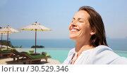 Купить «happy woman enjoying sun over infinity edge pool», фото № 30529346, снято 15 июня 2018 г. (c) Syda Productions / Фотобанк Лори