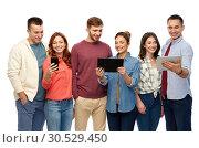 Купить «friends with smartphone and tablet computers», фото № 30529450, снято 10 ноября 2018 г. (c) Syda Productions / Фотобанк Лори