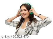 Купить «happy young woman or teenage girl with headphones», фото № 30529470, снято 10 ноября 2018 г. (c) Syda Productions / Фотобанк Лори