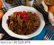 Купить «Stewed green beans with pepper», фото № 30529474, снято 18 апреля 2019 г. (c) Яков Филимонов / Фотобанк Лори