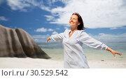 Купить «happy woman over seychelles island tropical beach», фото № 30529542, снято 15 июня 2018 г. (c) Syda Productions / Фотобанк Лори