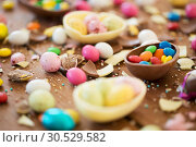 Купить «chocolate easter eggs and candy drops on table», фото № 30529582, снято 15 марта 2018 г. (c) Syda Productions / Фотобанк Лори