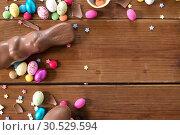 Купить «chocolate eggs, easter bunny and candies on wood», фото № 30529594, снято 22 марта 2018 г. (c) Syda Productions / Фотобанк Лори