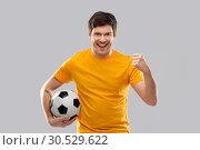 Купить «happy man or football fan with soccer ball winning», фото № 30529622, снято 3 февраля 2019 г. (c) Syda Productions / Фотобанк Лори