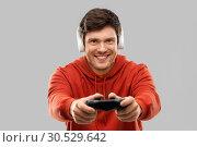 Купить «man with gamepad playing video game», фото № 30529642, снято 3 февраля 2019 г. (c) Syda Productions / Фотобанк Лори