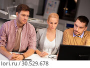Купить «business team with computer working late at office», фото № 30529678, снято 26 ноября 2017 г. (c) Syda Productions / Фотобанк Лори