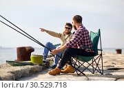 Купить «happy friends with fishing rods on pier», фото № 30529718, снято 8 сентября 2018 г. (c) Syda Productions / Фотобанк Лори