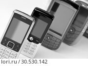 Купить «Row of mobile phones», фото № 30530142, снято 15 марта 2010 г. (c) Tryapitsyn Sergiy / Фотобанк Лори