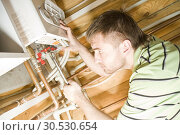 Купить «Plumber at work. Servicing gas boiler», фото № 30530654, снято 14 мая 2010 г. (c) Tryapitsyn Sergiy / Фотобанк Лори