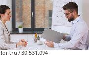 Купить «employer having interview with employee at office», видеоролик № 30531094, снято 29 марта 2019 г. (c) Syda Productions / Фотобанк Лори