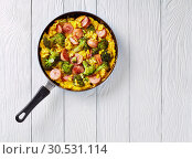 Купить «Omelette with broccoli and sausages in a skillet», фото № 30531114, снято 29 марта 2019 г. (c) Oksana Zh / Фотобанк Лори