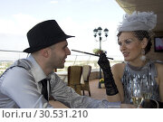 Talking retro couple in outdoor cafe. Стоковое фото, фотограф Tryapitsyn Sergiy / Фотобанк Лори