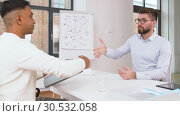 Купить «employer having interview with employee at office», видеоролик № 30532058, снято 29 марта 2019 г. (c) Syda Productions / Фотобанк Лори