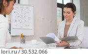Купить «employer having interview with employee at office», видеоролик № 30532066, снято 29 марта 2019 г. (c) Syda Productions / Фотобанк Лори