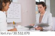 Купить «employer having interview with employee at office», видеоролик № 30532070, снято 29 марта 2019 г. (c) Syda Productions / Фотобанк Лори